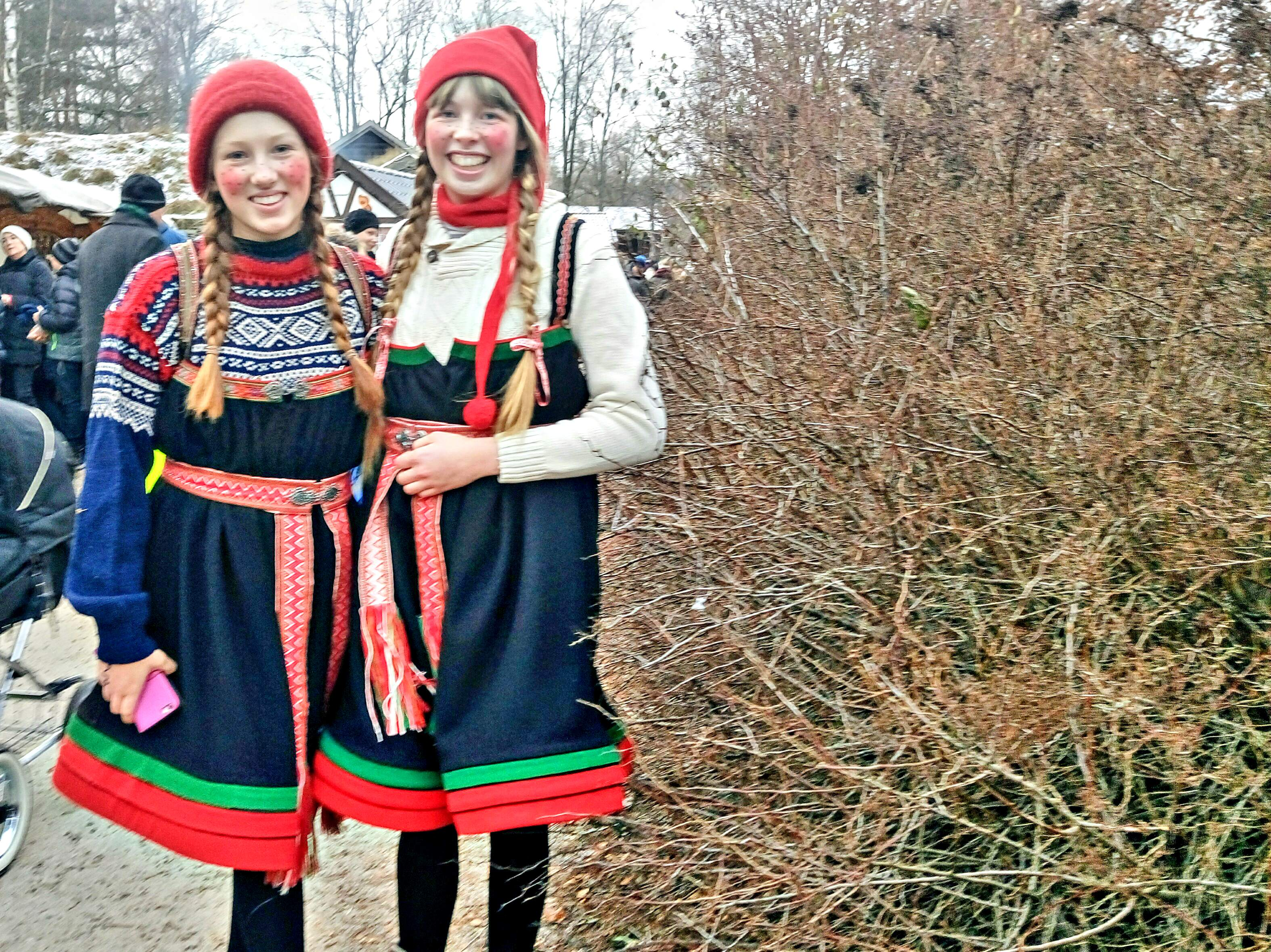 «Nisse» girls Iri and Runa, wearing a mix of traditional winter clothes.